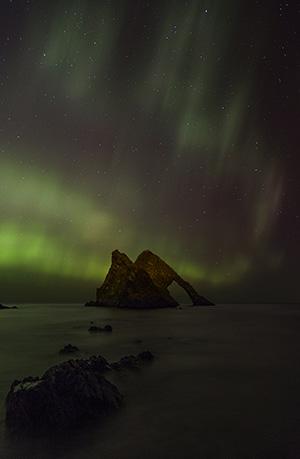 Aurora Borealis behind Bow Fiddle Rock