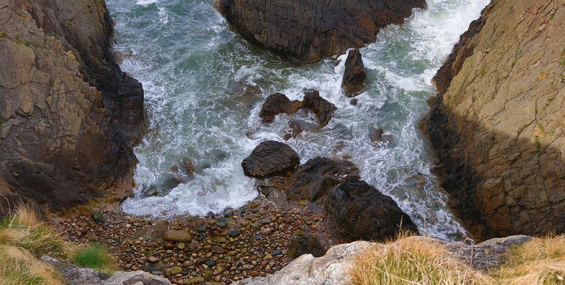 Dangerous cliffs at Bow Fiddle Rock, Moray
