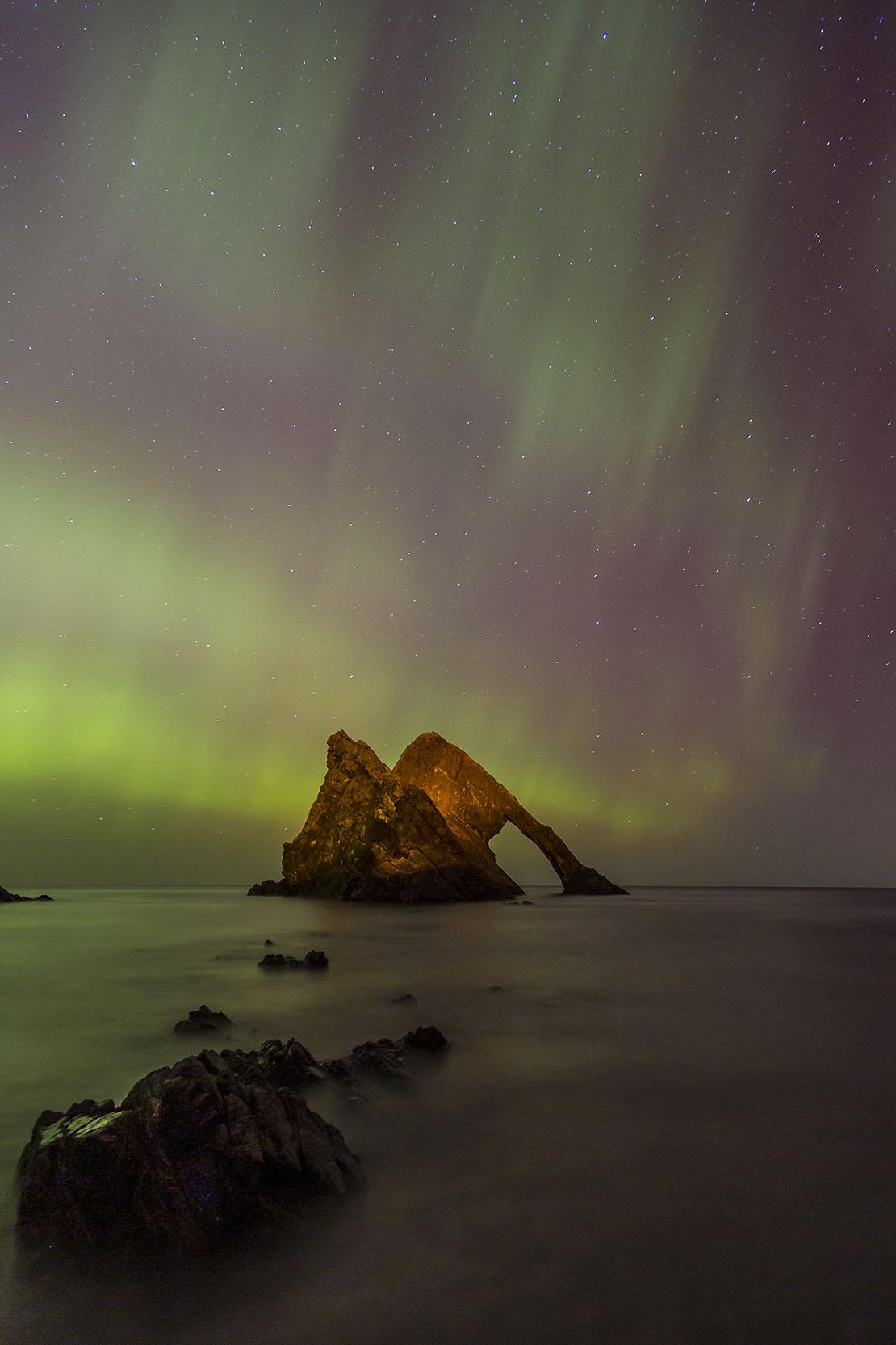 Aurora Borealis behind Bow Fiddle Rock   Aurora Borealis Scotland